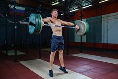 Free Muscular Fitness Man Preparing To Deadlift A Barbell Over His Head In Modern Fitness Center.Functional Training.Snatch Royalty Free Stock Photography - 113307297