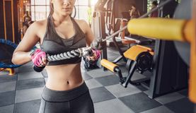 Muscular fitness woman doing exercises. Concept of healthy lifestyle. Cross fit bodybuilder in the gym stock image