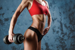 Muscular fitness woman, healthy lifestyle, Cross fit bodybuilder, athletic `s body, close up of young with barbell flexing muscles Royalty Free Stock Image