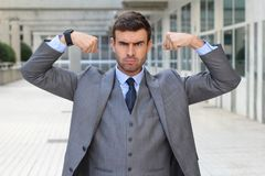 Muscular funny businessman flexing his arms Royalty Free Stock Photo