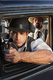 Muscular Gangster Shooting Gun Stock Images
