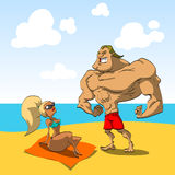 Muscular guy on the beach with a hot girl Royalty Free Stock Photo