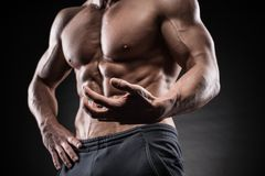 Muscular guy on black background Royalty Free Stock Photo