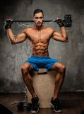 Muscular guy in blue shorts Stock Image