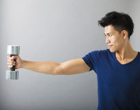 Muscular guy doing exercises Stock Photos