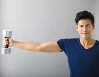 Muscular guy doing exercises Royalty Free Stock Image