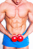 Muscular guy doing exercises with dumbbells over white background royalty free stock images