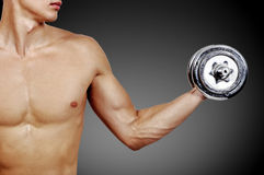Muscular guy with dumbbells Stock Photography