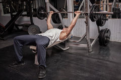 Muscular guy exercising in the gym Stock Photo