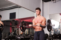 Muscular guy in the gym Stock Photos