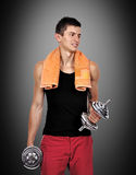 Muscular guy holding a dumbbells Stock Photos