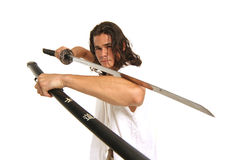 Muscular guy with Japanese sword. Thrilling to see individual open katana a single edged  Japanese sword Stock Image