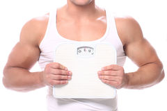 Muscular guy with scales Stock Images