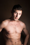 Muscular guy without a shirt Royalty Free Stock Photo