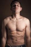 Muscular guy without a shirt Royalty Free Stock Photos