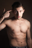 Muscular guy without a shirt Royalty Free Stock Images