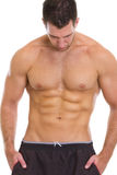 Muscular guy showing abdominal muscles Royalty Free Stock Photography