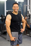 Muscular gym trainer Stock Photos