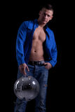 Muscular handsom man holding a disco ball Stock Photography