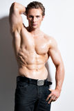 Muscular handsome man with hands behind head. Royalty Free Stock Photos
