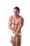 Muscular handsome man holding his arm in pain Royalty Free Stock Photography