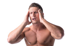 Muscular handsome man holding his head with for Royalty Free Stock Photo