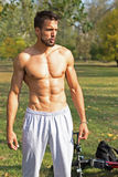 Muscular Handsome Man in Outdoor Gym. Naked Torso. Street Workout. Stock Photography