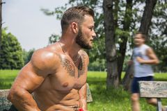 Muscular Shirtless Hunk Man Outdoor in City Park. Muscular Handsome Shirtless Hunk Man Outdoor in City Park. Showing Healthy Muscle Body Stock Images