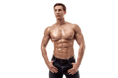 Muscular handsome young man with naked torso. Isolated on white background. Copy space Stock Photography