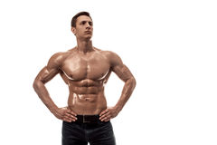 Muscular handsome young man with naked torso. Isolated on white background. Copy space. Muscular handsome young man with naked torso. Isolated on white Royalty Free Stock Photography