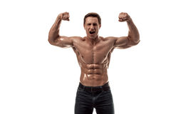 Muscular handsome young man with naked torso. Isolated on white background. Studio shot on white background Royalty Free Stock Photography