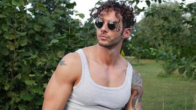 Muscular Hunk Man Outdoor in Countryside. Handsome Muscular Hunk Man Outdoor in Countryside Standing on Grass. Showing Healthy Muscle Body While Looking away Royalty Free Stock Image