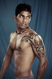 A muscular Indian man Royalty Free Stock Image