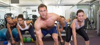 Muscular instructor leading kettlebell class Royalty Free Stock Images