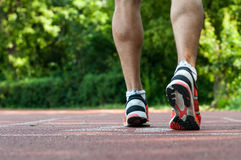 Muscular legs waiting at the starting line Royalty Free Stock Photo