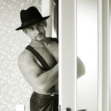 Muscular macho in a felt hat Stock Photography