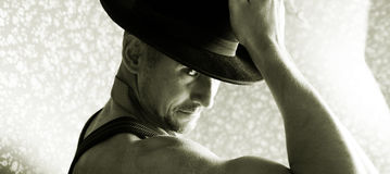Muscular macho in a felt hat Royalty Free Stock Images