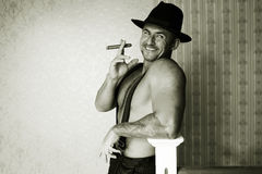 Muscular macho in a felt hat Royalty Free Stock Photography