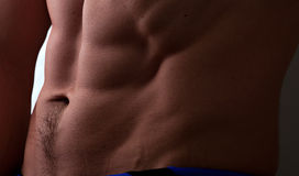 Muscular male abdomen. Muscular caucasian male abdomen closeup Stock Photo
