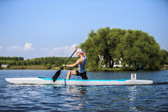 Muscular male athlete in a canoe rowing Stock Photo