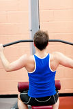 Muscular male athlete practicing body-building. In a fitness center Royalty Free Stock Images