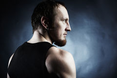 The muscular male back on black background Royalty Free Stock Photo