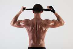 The muscular male back on white background. Isolated Royalty Free Stock Image