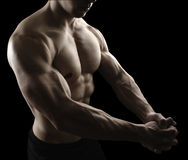 Muscular male body on black background Royalty Free Stock Photos