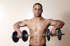 Muscular male body, lifting dumbbells Stock Photo