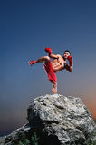 Muscular male boxer training outdoors Stock Image