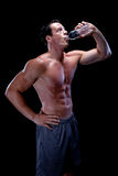 Muscular male drinking water Royalty Free Stock Image
