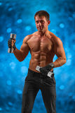 A muscular male with dumbbells Royalty Free Stock Photo