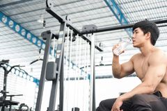 Muscular male having pain on shoulder in gym.  young man injure Stock Images