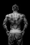 Muscular male model bodybuilder preparing for fitness training Royalty Free Stock Images
